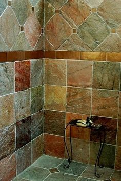Shower tile design -  All different tiles! To heck with trying to match a certain *style*, just pick a material and tile in all different kinds. One breaks or needs replacing? NO PROBLEM!