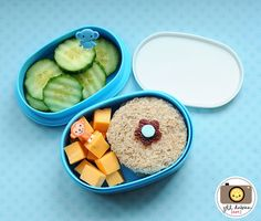 Meet the Dubiens blog    This bento was for her afternoon nutrition break. She had a turkey sandwich cut into a circle with a fruit leather and sprinkle flower. She also had some cheddar cheese cubes with a monkey pick and some crinkle cut cucumbers with an elephant pick.