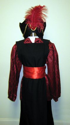 Jafara- red silk robe, black overlay, red scarf belt, foam shaped hat with feather and jewel?