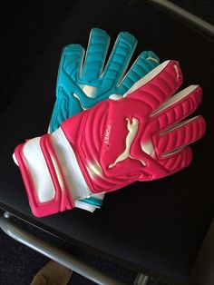 New @PUMA evoPOWER Tricks Gloves. The right hand is pink. The left hand is blue.