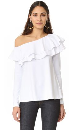 Move over, off-the-shoulder necklines! This season, one-shoulder tops are stealing the spotlight along with all things asymmetrical.