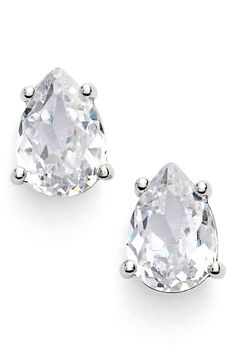 Prong-set cubic zirconia stud earrings glitter from all angles due to the multifaceted pear-shaped cut of the icy stones.
