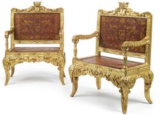 A PAIR OF LARGE SPANISH CROWNED ARMORIAL CARVED GILTWOOD ARMCHAIRS CIRCA 1830 with a monogram T below a coronet and upholstered leather decorated with the arms representing Anguilar of Extremadura.