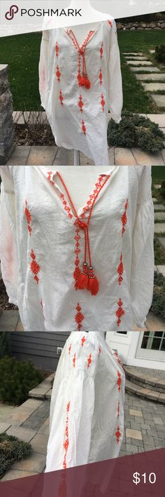 """H&M Cream Tunic Cover Up Orange Embroidery Tassel Beautiful cream, boho style tunic with orange embroidery & orange tassels with silver tone beads.  It's a size 6 or small.  Approximate measurements are:  22"""" across under arms,   34"""" long in back, 27"""" long in front, & 22"""" sleeves.  This is meant to fit roomy.  Can be used as swim cover up, tunic top or dress!!  The material is sheer, but not completely see through.  It has a wide neckline & buttons at the sleeve hems. H&M Tops Tunics"""