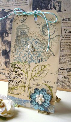Handmade vintage-themed hydrangea collage tag, embellished with small pearls and dimensional flower, tied with baker's twine