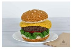 Food is the best source of inspiration for amigurumi's and for making them look yummily delicious. Add eyes and smile to the burger for a kawaii look.