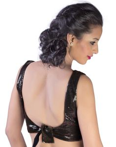 A sequinned sheeting georgette black blouse with sweetheart neckline.