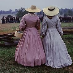 women in period clothing at Manassas National Park during a reenactment of a Civil War battle.