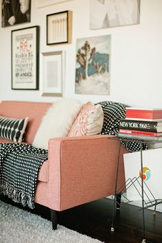 pink couch, white walls, textured decor