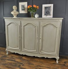 We've painted this stunning Oak Sideboard from France in Annie Sloan Paris Grey with Farrow & Ball Shaded White edging detail. Dark wax has been used to give an aged effect. This typical French design provides drawer and shelf storage and would make the perfect addition to a lounge,hallway or bedroom. http://www.thetreasuretrove.co.uk/cabinets-and-storage/large-french-shabby-chic-sideboard-in-paris-grey