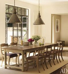 Suzanne Kasler's house in AD-kitchen dining (love the light fixtures)