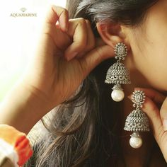 Make these beautiful pearl dropped jhumka all yours. Perfectly designed to bring out the traditional women inside Aquamarine Jewelry, Diamond Jewelry, Diamond Earrings, Silver Jewelry, Diamond Jhumkas, Indian Earrings, Indian Jewelry, Pearl Jhumkas, Silver Jhumkas
