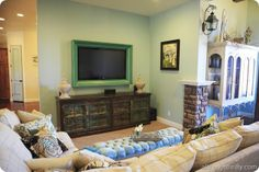 @Jackie Johnson...this is what I was talking about when I said sheet rock your niche in and then frame your tv. It would look fantastic!