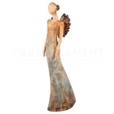 Marlene Pottery  An exquisite handmade pottery piece that is a unique and traditional work executed in a modern style. Bring style and elegance to your home with this angel with a turquoise and brown patina.