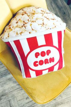 If you're stuck on a party favor for your guests, treat them to one of these adorable popcorn pillows. Place one on each seat so that they can lay back and relax while they watch the movie. It's an awesome party favor that they can take home with them to remember the fun time they had at your party. See more party ideas and share yours at CatchMyParty.com #catchmyparty #partyideas #movienight #movienightparty #popcornpillow