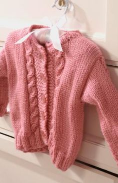 Dress your little girl up in the Pretty Princess Baby Cardigan. This beautiful knit baby cardigan pattern is a fun way to incorporate a little pink and purple into her miniature wardrobe. Baby Cardigan, Cardigan Bebe, Baby Pullover, Cardigan Pattern, Knit Cardigan, Baby Knitting Patterns, Knitting For Kids, Crochet For Kids, Free Knitting