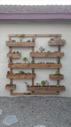 diy wall decor ads/ Amazing Vertical Garden Ideas for Wall Decorations A living wall, or vertical garden, is a collection of wall-mounted plants. Vertical wall gardens are the latest tre Garden Wall Designs, Garden Wall Art, Wall Art Designs, Garden Mural, Back Gardens, Outdoor Gardens, Vertical Garden Wall, Vertical Gardens, Verticle Herb Garden