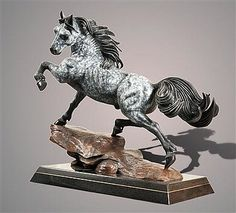 "Barry Stein Bronze Sculpture The Stallion in dapple gray. A magnificent thoroughbred horse with a long black flowing tale & mane. Mounted on a fused, two piece, highly polished, swivel granite base and then separated by a thin slice of shiny brass.  Approximately 28""long x 27"" high."