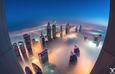 Heavenly_Photographs_of_Dubai_Skyscrapers_in_a_Sea_of_Clouds_by_Daniel_Cheong_2014_12