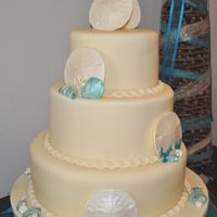Beach themed, teal with ivory sand dollars.