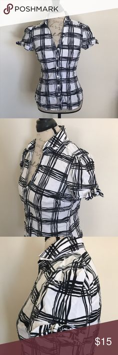 Express Button Down Shirt Express design studio short sleeve button down shirt. Size small. Black and white pattern. Cap sleeve with buckle detail. 97% cotton 3% spandex. Express Tops Button Down Shirts