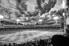 @fenwaypark home of the @redsox. #boston #bostonma #baseball #baseballpark #fenway #redsox #redsoxnation #monochrome #blackandwhite #clouds #lights #cocacola #grass