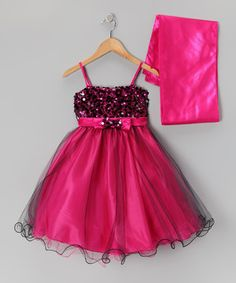 Satin fabric, a bow-embellished waist and a stunning sequin bodice make this luxurious dress a piece of poufy perfection. With an easy-on back zipper, sheer overlay and coordinating shrug, this fabulous frock will pretty-up any little princess.