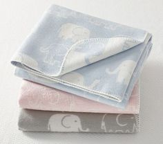 I love the Elephant Stroller Blanket on potterybarnkids.com for boy or girl!