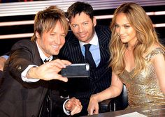 Harry Connick Jr.  and his American Idol co-judges Jennifer Lopez and Keith Urban pose for a selfie.