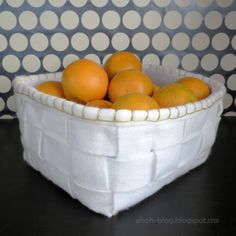 DIY felt basket.  I love how this basket adds a soft touch to the kitchen counter.  Tutorial by Ama R on Cut Out and Keep.