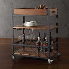 This Myra rolling serving cart features a weathered, timeworn patina allowing traces of natural wood and original colors to show through. The frame is made of black sand metal with 3-tier storage area for an industrial, modern touch to your kitchen.
