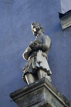 Stone statue on the facade of the church Niguliste, Tallinn, Estonia