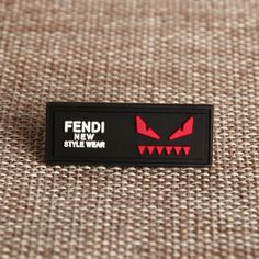 FENDI PVC Patches is a label about 2 inches, and it can be sew on clothing through its sewing groove. So how to make PVC patches for clothing? GS-JJ is a PVC patch manufacturer, customers could customize PVC patches at our custom system in a cheap price. Price Tag Design, Fendi, Metal Font, Shirt Label, Pvc Patches, Aesthetic Shirts, Mens Travel Bag, Clothing Labels, T Shirt And Jeans