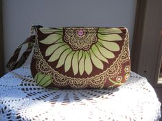 Check out this item in my Etsy shop https://www.etsy.com/listing/462844584/wristlet-zipper-gadget-pouch-in-lotus