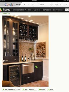 I like the cabinet layout. But just shelves for liquor instead of wine racks.