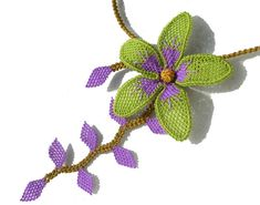 She does absolutely beautiful work. Lime green purple lilac needle lace crochet orchid by LandofDante