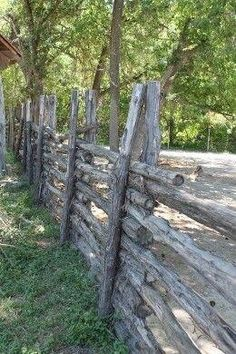 Post and rail fence. With this type of fence, posts do not need to be implanted into ground. Sinching top and bottom (above and below horizontals) w/paracord or zipties, provides stability and rigidity. Log Fence, Rustic Fence, Rail Fence, Pallet Fence, Outdoor Projects, Garden Projects, Craft Projects, Country Fences, Garden Fencing