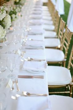 white table cloth, gold chairs