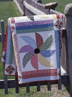 Combine machine appliqué and machine piecing to produce this lively quilt  featuring 1930s reproduction prints.