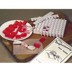 Quickly mold old-fashioned sour candy blocks with this clever form. Mold up to sixty-four 1/2 x 1/2 x 3/4 blocks at a time. Interlocking, plastic partitions. Includes instructions, recipes and 1 package of wax twist wrap. Hi-temperature plastic. This material is manufacturerd to withstand tempertures up to 310 degrees. Instructions and recipes included.   Recipe included will yield approximately 90 - 110 pieces.