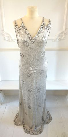 1930's full-length evening dress or vintage wedding dress with extensive beadwork and rhinestones.