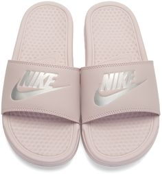 premium selection 9c972 ca60d Nike - Pink  Benassi Slides. Faux-leather slip-on sandals in