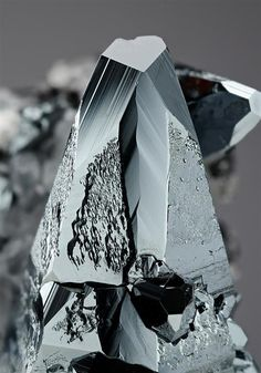 An excellent lustrous steeply pyramidal with pinacoid termination crystal of metallic black Hematite measuring to cm tall displays well on the specimen associated with colourless-white Calcite crystals and further crystals of Hematite. Crystals And Gemstones, Stones And Crystals, Raku Pottery, Calcite Crystal, Mineral Stone, Rock Formations, Rocks And Gems, Rocks And Minerals, South Africa