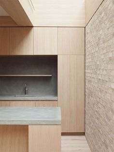 Minimalist kitchen in house designed by Erbar Mattes.