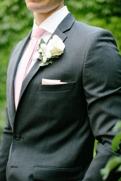 Great groom's look for Spring, charcoal suit with pastel pink tie and classic boutonniere