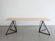 Steel Stand Table is a minimalist design created by Germany-based designer Sebastian Scherer. The base is composed of a triangular metal structure made of powder coated steel. (1)