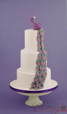 Purple Peacock Cake.. shouldnt' be solid white though