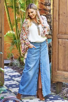 You love walking through the sand, your guitar in hand and a daisy chain through your hair. You're a gypsy princess and you love your Dusty Footprints Button Skirt, it will never go out of style.  This clever denim maxi features a soft, slightly distressed denim making it a key piece in your wardrobe. It will work with anything you pair it with. The button through feature allows you to button or unbutton making it versatile and personalized to you. Team with a tank and strappy sandals for…