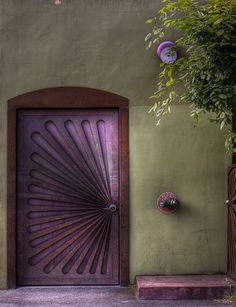 YES IT IS PURPLE AND LOOKS LIKE PLEATED FABRIC, RATHAN THAN A WOODEN DOOR.......SO NEAT..........ccp