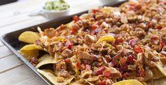 Chicken Fajita Nachos with chipotle marinated chicken chopped up with seared…
